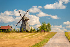 Free Mill And Rural House Near Road Stock Photo - 68326110