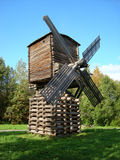 Mill in Arkhangelsk. Wood windmill in Arkhangelsk with blue clear sky,with nature royalty free stock photography