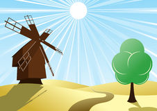 Mill on the background of the wheat fields Royalty Free Stock Images