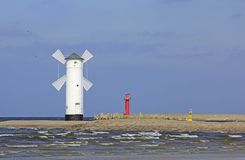 Mill beacon Swinoujscie. The historical mill beacon at the harbor entrance from Swinoujscie, Island of Usedom, Baltic Sea, Poland Stock Photo