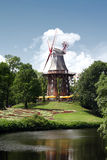 Mill, Bremen, Germany. Herdentor mill in Bremen, Germany. Sunny with flowers Royalty Free Stock Photos