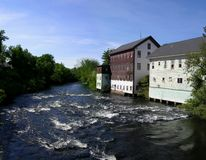 Mill Buildings. Old mill buildings on a river in New Hampshire stock images