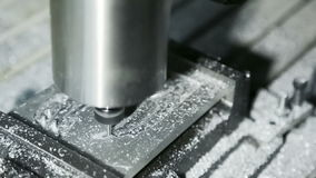Mill Cutting Aluminum: close-up shot. Royalty Free Stock Image