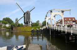 Mill and Drawbridge. Wind mill and drawbridge in Leiden, Holland Stock Image