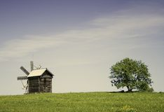 Mill field. Mill in the field of green Royalty Free Stock Images