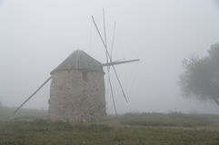 Mill in the fog Stock Images