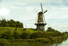 Mill in Holland. Mill and lake close to Lovestein, Holland Stock Image