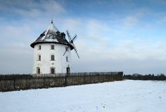 Mill house. White windmill in winter landscape Stock Photos