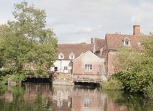 Mill house at flatford mill in suffolk with river water in front Royalty Free Stock Photography