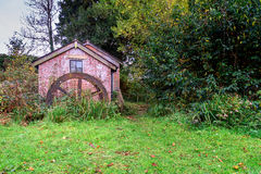 Mill house. Old mill house with mill wheel in the foreground royalty free stock photo