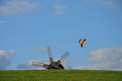 Mill and kite Stock Images