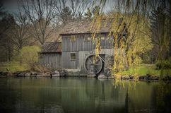The Mill at Midway Village. A view across the pond at Midway Village in Rockford, Illinois of the mill royalty free stock photos