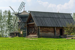 Mill and old wooden rustic house. A sunny summer day Stock Image