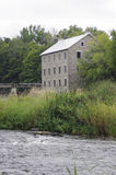 Mill on river Royalty Free Stock Image