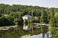 Mill on a river in Rural France Stock Photo