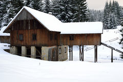 Mill. Snowy old mill in the winter mountains stock photos