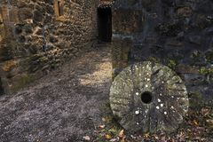 Mill stone in El Pobal ironworks. In Muskiz royalty free stock images