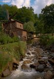 Mill by the stream Royalty Free Stock Photo