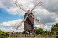 Mill in summer day Stock Photos
