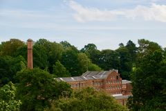 Mill among the trees. Quarry bank mill wilmslow Cheshire England united kingdom royalty free stock photo