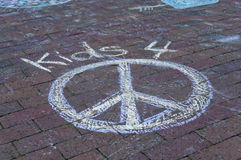 Mill Valley Plaza. Child's chalked peace symbol on town brick plaza Royalty Free Stock Photography