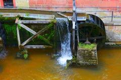 Mill wheel. On stream Leuk ( too Leukbach ) in Saarburg, Rheinland-Pfalz, Germany, summer Royalty Free Stock Photo