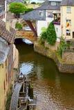 Mill wheel. S on stream Leuk ( too Leukbach ) in Saarburg, Rheinland-Pfalz, Germany, summer Stock Photos