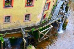 Mill wheel. S on stream Leuk ( too Leukbach ) in Saarburg, Rheinland-Pfalz, Germany, summer Stock Photo