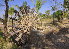 Mill wheel on the Mekong River Royalty Free Stock Photo