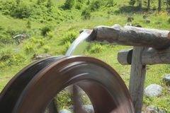 Mill wheel in th austrian mountain Stock Photo
