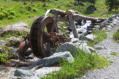 Mill wheel in th austrian mountain Stock Photos
