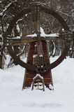 Mill wooden decoration in winter Park stock images