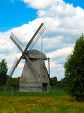 Mill. Wooden windmill against the blue sky royalty free stock image