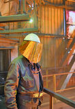 Mill worker with hot steel. Inside of steel plant Royalty Free Stock Images