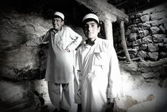 Mill workers in Afghanistan. Two boys working in a mill in Azra district, Logar province, Afghanistan Stock Photography