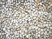 Millares de pequeñas piedras redondas foto de archivo