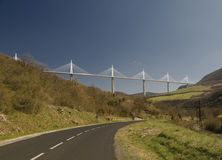 Millau Viaduct France. WS shot from west of the Millau Viaduct, in Languedoc, S France deserted road in foreground Royalty Free Stock Photos