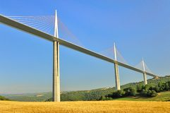 Millau viaduct valley, France. The valley fields, below the impressive Millau viaduct, in southern France, conveying the A75 motorway royalty free stock image