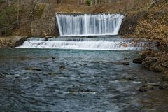 A Horizontal View of the Dams at Douthat State Park - 2 stock images