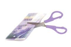 Mille banconote del franco svizzero con le forbici valuta dello swi Immagini Stock