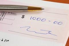 Mille dollars de chèque photo libre de droits