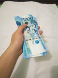 Mille factures de peso philippin Photographie stock