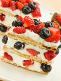Mille feuille. Strawberry-blueberry mille feuille with whipped sour cream. Shallow dof Royalty Free Stock Photos