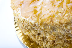 Mille feuille cake. Macro shot of mille feuille cake in brown glossy plate Stock Photography