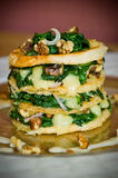 Mille Feuille Starter. Of spinach, cheese and walnuts all stacked within layers of filo pastry Royalty Free Stock Images