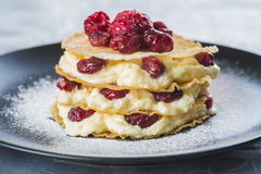 Mille-feuilles with cream and cramberries. Mille-feuilles with custard cream and dried cramberries for dessert royalty free stock image