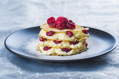 Mille-feuilles with cream and cramberries. Mille-feuilles with custard cream and dried cramberries for dessert royalty free stock photo