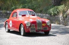 Mille Miglia, la course célèbre pour de rétros voitures Photographie stock libre de droits
