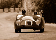 Mille Miglia race (*). Mille Miglia race along a mountain road in Italy - antiqued shot Stock Photo