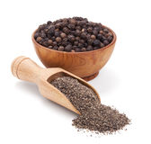 Milled black pepper on white royalty free stock image